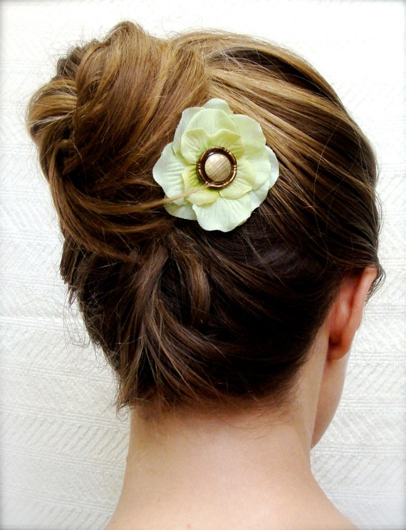 light green hydrangea fascinator in ombre updo