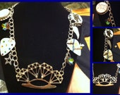 Silver rhinestone diamond brass knuckle, bottle cap, rhinestone guitar pick, wings, star necklace