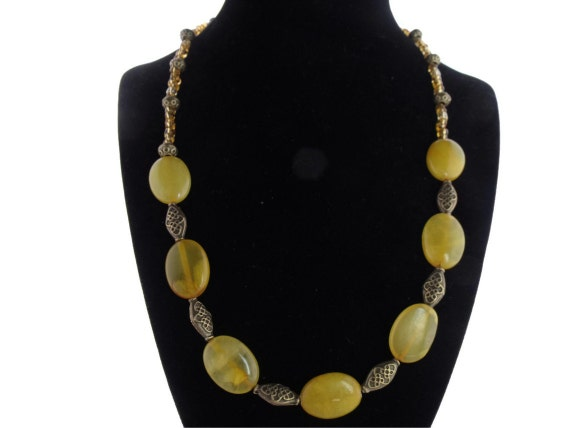 statement necklace, dyed yellow jade beads, oval beads, gold spacer beads, magnetic clasp