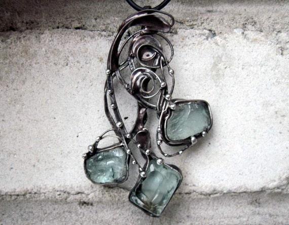 Handmade pendant with raw Aqua Quartz