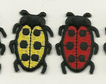 red and yellow ladybugs  4 pcs.