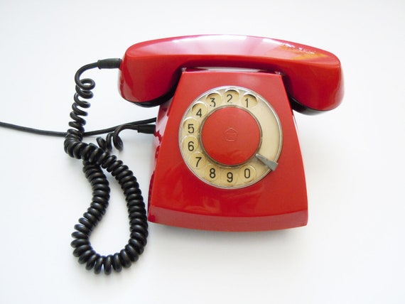 Vintage Russian dial rotary telephone red color.