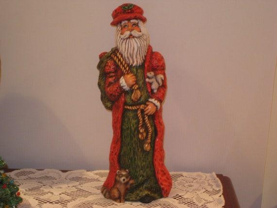 "Christmas, Ceramic Santa ( looks like he was carved) hand painted by Joan Davis, 15"" tall"