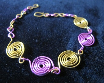 Bracelet wire wrapped spirals in hot pink and yellow
