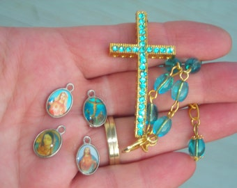 DECADE ROSARY BRACELET with large rhinestone/crystal cross & aqua ocean glass beads and medals charms