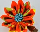 Orange, neon green and neon yellow batik fabric kanzashi hair clip