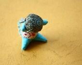 Sarubobo the little Japanese faceless cloth baby orange and blue head farfalle beads