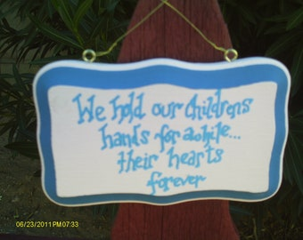 We hold our childrens hands sign 2