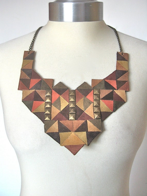 KUDOS TO CUBISM statement suede bib necklace in shades of brown with pyramid studs