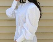 White high-neck blouse