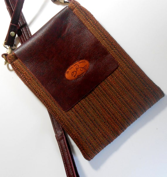 Small brown shoulder bag, will fit your e-reader.