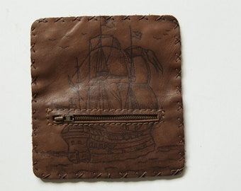 Handmade leather tobacco pouch in dark brown.