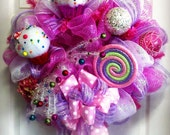 pink and lavender deco mesh wreath with cupcakes and a lollipop