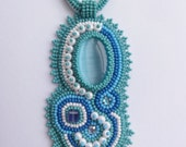 Beaded cabochon whinter design