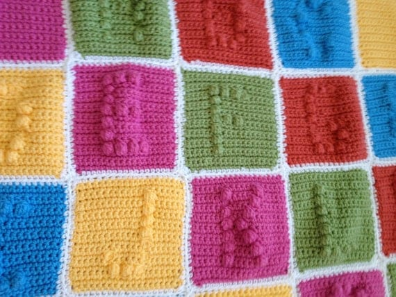 Crocheted alphabet afghan. Letters raised in puff stitch.