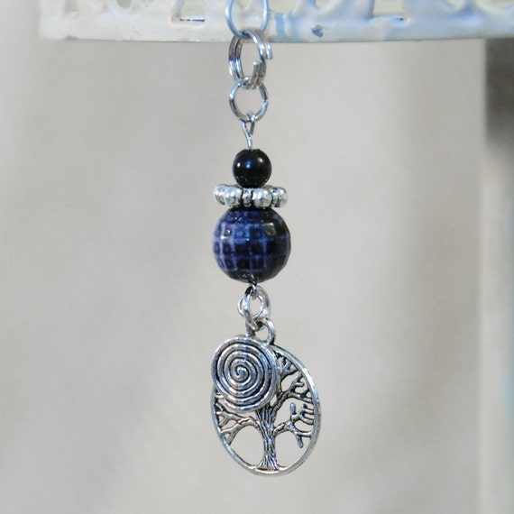 Tree and Spiral Charm with a Blue Bead