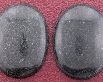 two large 40x30 oval black stone cabochon
