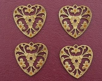 four ornate vintage heart brass filigree findings