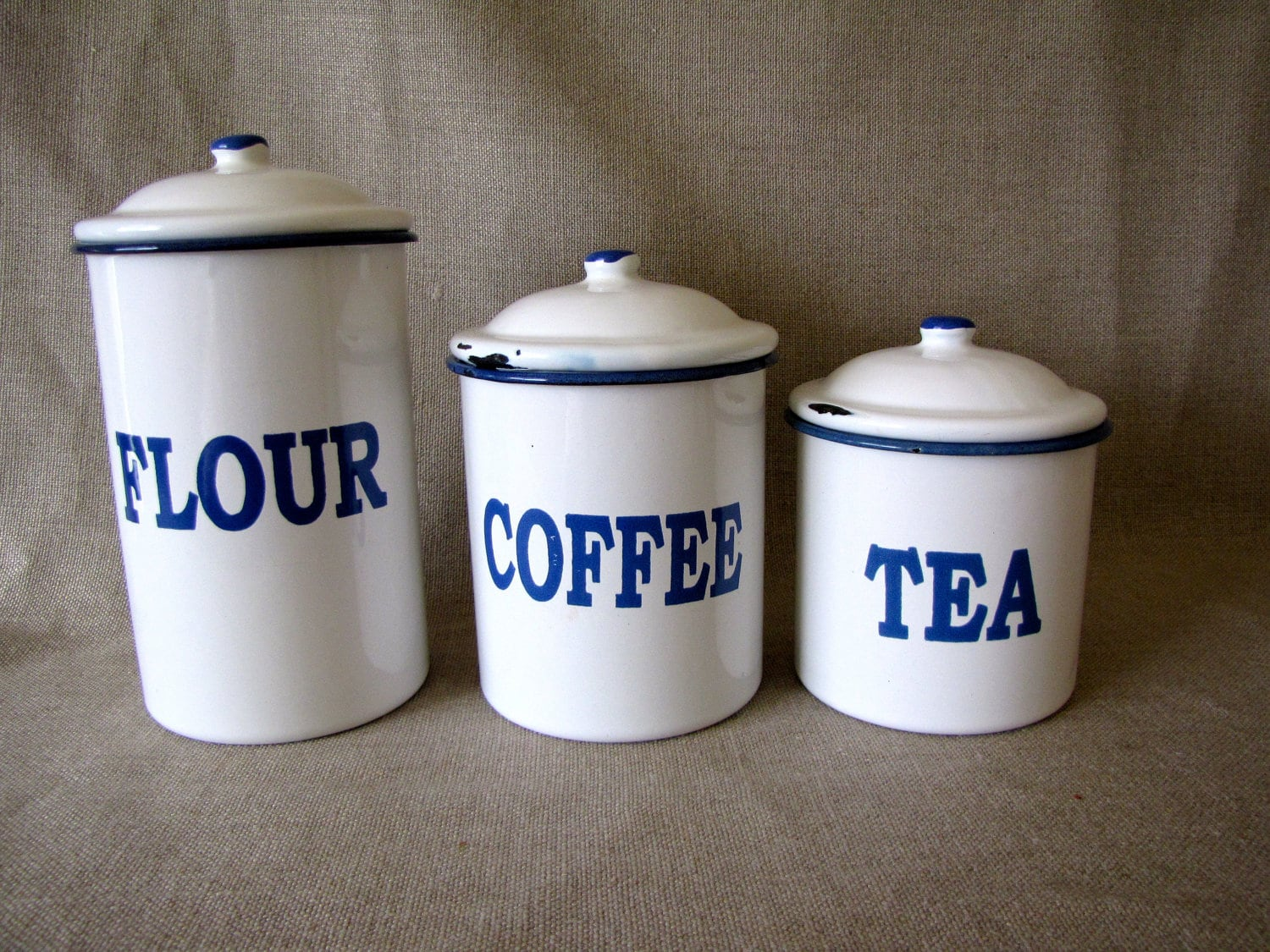 Set of vintage blue and white enamel kitchen canisters for Blue kitchen set