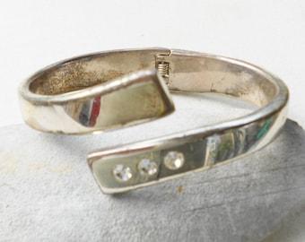 Vintage cuff a grungy metal and rhinestone bracelet 1970s vintage cuff arm jewelry