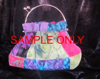 Purse with multiple water-colored print fabrics in Batik cotton, with interchangeable clasp handle. ITEM 001