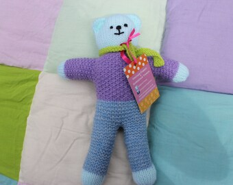 Very loveable hand knitted teddy
