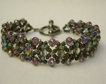 Filigree bracelet with sparkling beads in green and violet