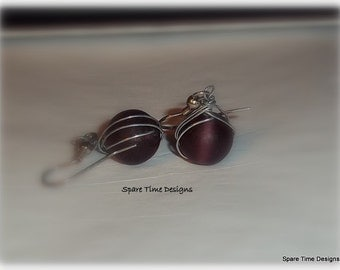 Wire wrapped round cranberry beaded earrings