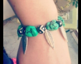 Faux turquoise bracelet with metal feather beads