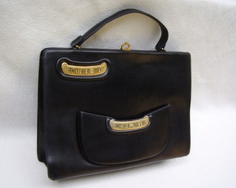 "EXTREMELY RARE 1940/50's "" ROSENFELD""  Handbag decorated with Two plaques with the well known phrase ""Another Day Another Dollar""Stunning."
