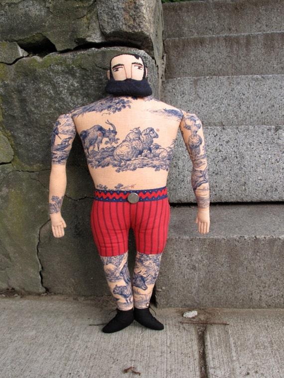 Big tattoo man with Forelock