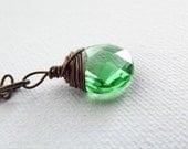 Brass wire wrapped emerald green teardrop