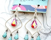 moroccan sunset. chandelier earrings with orange and turquoise teardrops.