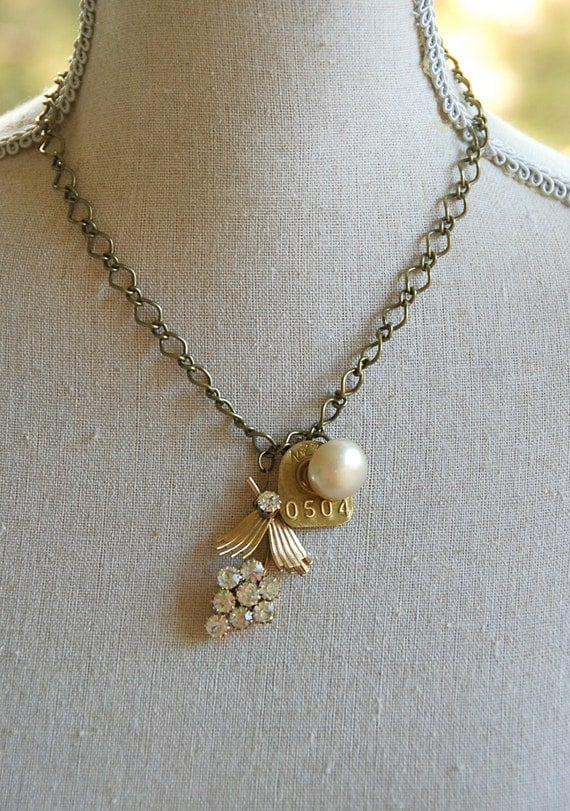 Sophisticated lady. vintage assemblage rhinestone charm necklace