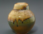 Vase, woodfired porcelain with secret shino and natural ash glazes