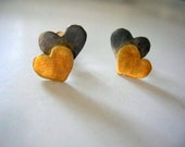 oxidized and gold plated sterling silver double heart stud earrings.