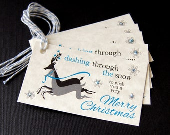 Dashing Through The Snow Reindeer Christmas Tags (blue) or Package Labels on Natural Cream (Qty. 5)