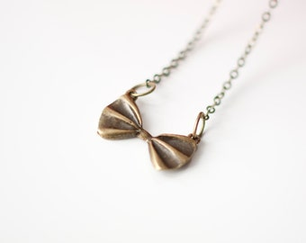 Little bow necklace. Sweet, simple and feminine necklace with a small bow. Antiqued bronze.