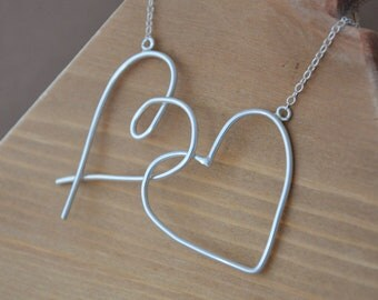 Sterling Silver Heart and a Kiss Necklace.