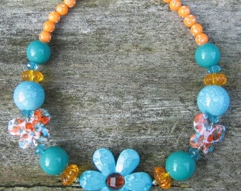 Daisy Butterflies Chunky Bead Stretch Necklace (Teal & Orange): power jewelry for little girls