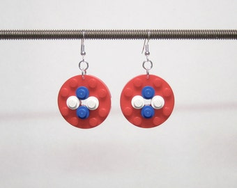 Red disk earrings with white and blue pieces and silver plated ear wires