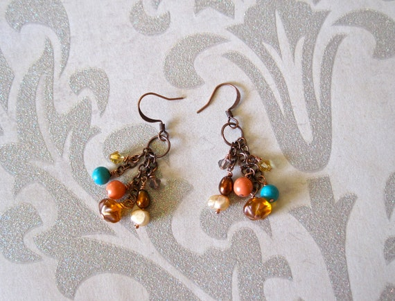 colorful beaded cluster earrings. copper. amber colored lampwork. honey gold crystals. bronze and cream pearls. peach coral glass pearls.