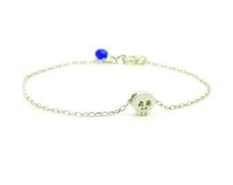 Tiny Skull Bracelet - Matt Rhodium Plated Skull Charm on Silver tone Delicate Chain w/ Cobalt Blue Pendant