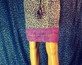 Purple leopard  print skirt with lace and grizzly feathers
