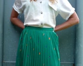 Jade Green Mid Length Shiny Pleat Skirt With Geometric Designs