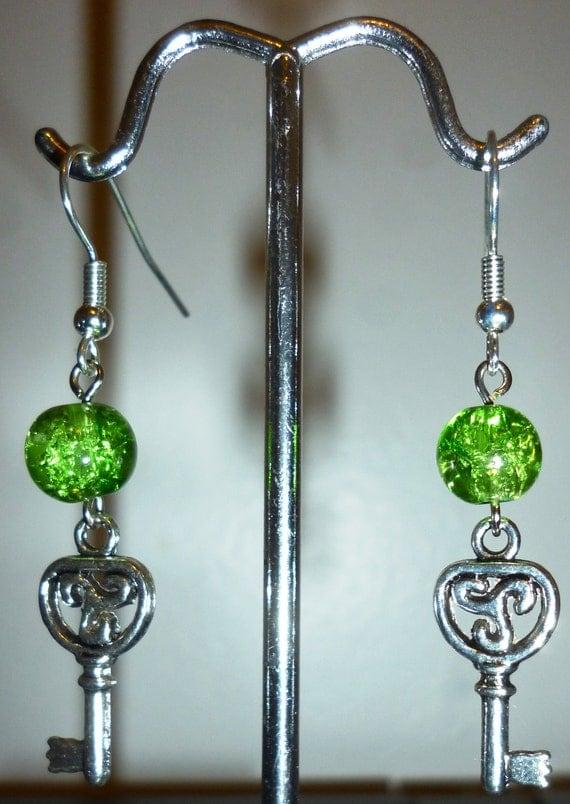 Metallic keys and green crackle glass bead dangle earrings