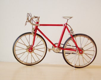 Red racing bike miniature,vintage collectible toy, red bicycle, movable parts bicycle, retro racing bike in scarlet, early ninieties