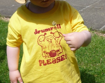 Drumroll Please Children's T-shirt: hand-printed yellow cotton.