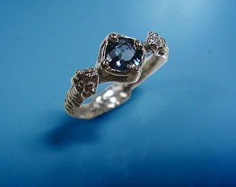 Topaz snake ring, with London blue topaz  - solid sterling silver.