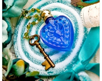 my devil's heart is blue - natural perfume oil held captive within a heart of blue glass - over 60 natural aroma options